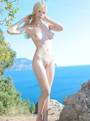 Teen posing as sea nymph